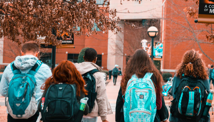 A group of students head to school at a CPS high school.